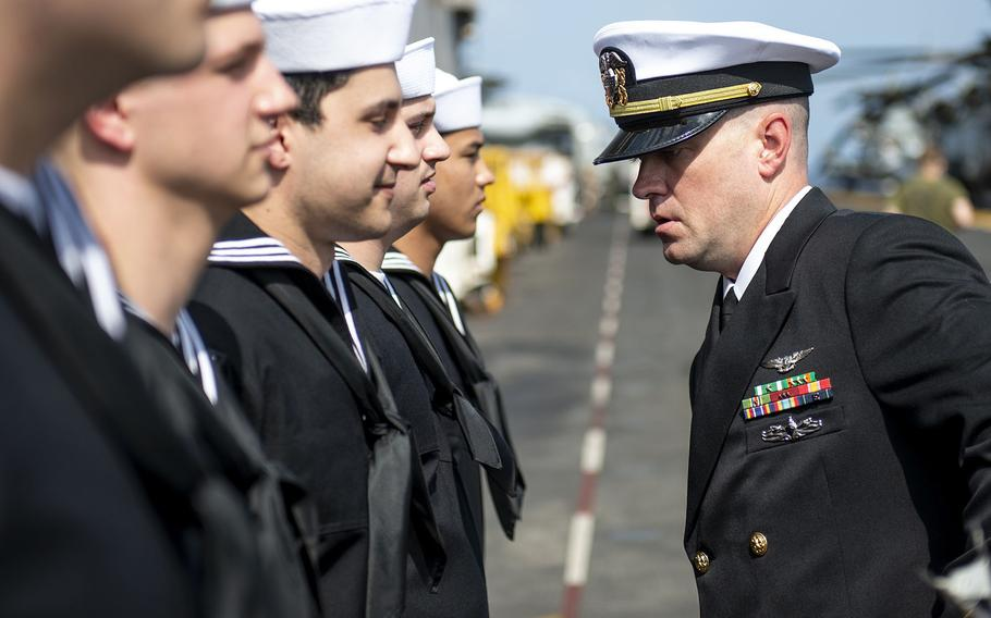 An officer inspects sailors aboard the USS Boxer amphibious assault ship in the Arabian Sea, Sept. 20, 2019.