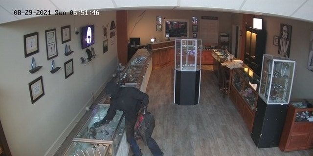 The suspect broke into the store early Sunday morning dressed in all black.