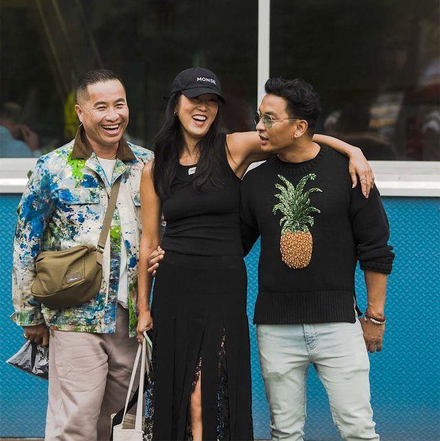 three people at new york fashion week spring 2022 street style